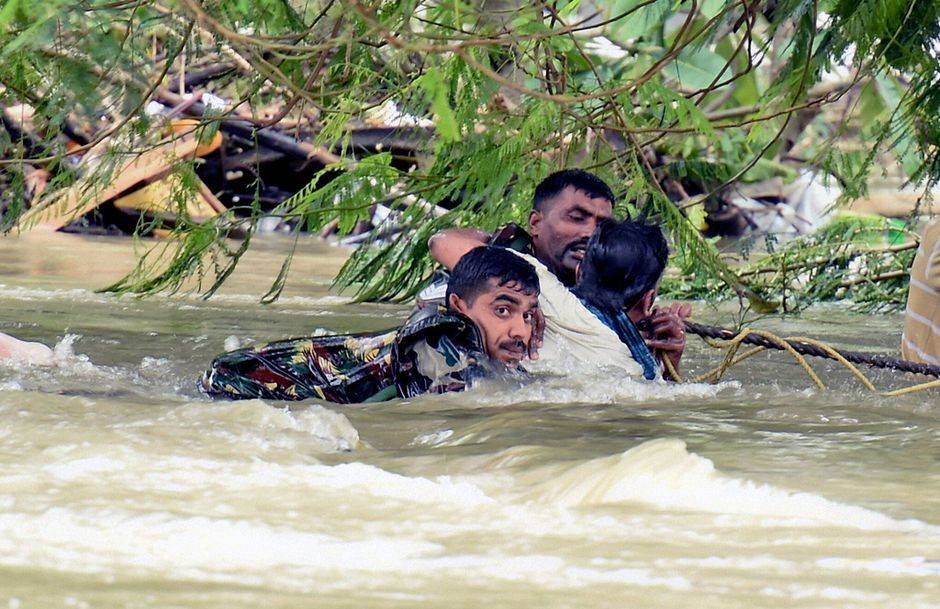 People trying to save their lives in the floods
